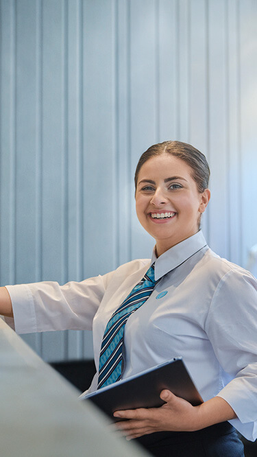 Hospitality Courses and Degrees | Torrens University Australia | Woman Hotel Management Uniform Smiling | Large
